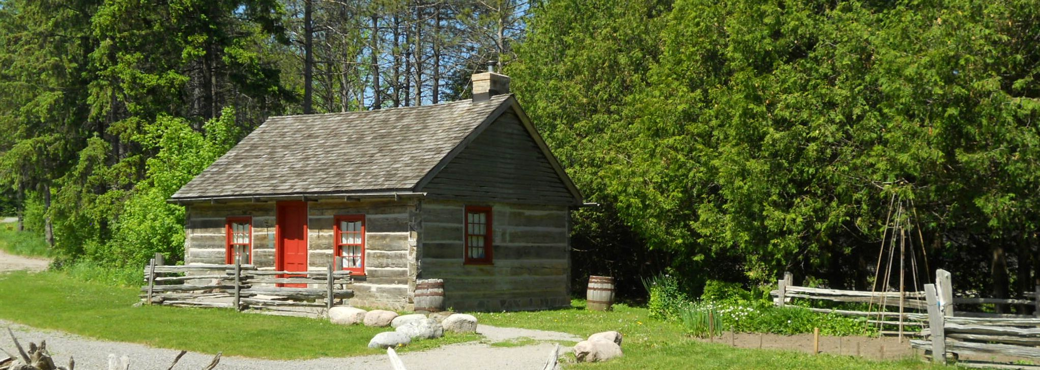 Image of log cabin on Museum grounds