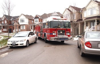 Fire Truck cannot get through cars parked across eachother on a residential street